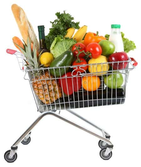 shopping trolley full of healthy fruit, vegetables and other food