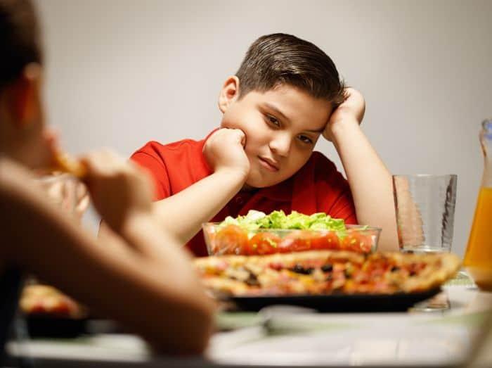 overweight teen eating salad